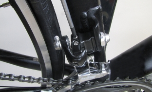 Picture 3: Adjusting of screw for largest chainring, next to it the screw for the smallest chainring